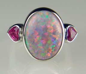 Black opal and pink sapphire heart ring in platinum