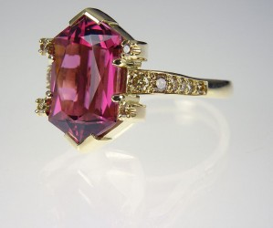 Rubellite & golden diamond ring in gold