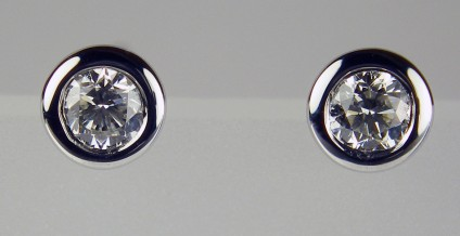 0.20ct diamond stud earrings in 18ct white gold - 0.20ct pair of diamonds in G colour VS clarity rubover set in 18ct white gold