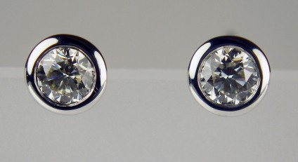 0.37ct diamond earstuds in 18ct white gold - 0.37ct pair of round brilliant cut diamonds in G colour VS clarity rubover set in 18ct white gold.
