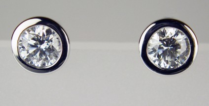 Diamond earstuds 0.50ct - 0.50ct total diamond weight earstuds rubover set in 18ct white gold. Diamond quality G colour VS clarity.
