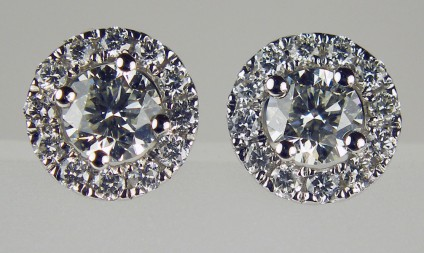Diamond cluster earstuds in 18ct white gold - 0.55ct total diamond weight, pretty flower cluster earstuds in 18ct white gold. Diamonds are G colour VS clarity.