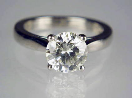 1.55ct diamond solitaire ring in platinum - 1.55ct round brilliant cut diamond solitaire.  The diamond is 7.57mm in diameter and is estimated to be of J colour VVS clarity (it does not have any independent grading report).  It is mounted in a platinum ring size J1/2.
