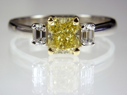 Yellow Diamond Ring in Platinum - Yellow Diamond Ring 1.22ct fancy intense yellow radiant cut diamond (GIA certificated) set with 30 points of emerald cut diamond in platinum.