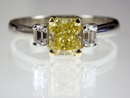 Yellow Diamond Ring in Platinum - Yellow Diamond Ring 1.22ct fancy intense yellow radiant cut diamond (GIA certificated) set with 30 points of emerald cut diamond in platinum.