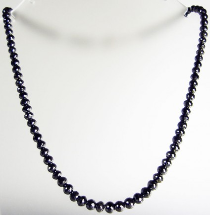 107ct black diamond necklace - necklace made up of 107ct of faceted black diamond round beads with 14ct white gold and diamond clasp.  Necklace is 43ct long and diamond beads range from 4.3 - 6.1mm in diameter.