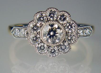 Diamond cluster ring - Diamond cluster ring in 18ct white and yellow gold. Total diamond weight 1.00ct. Diamond quality G colour VS clarity. Diamonds mounted in white gold, ring shank in yellow gold.