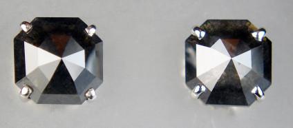 Rose cut black diamonds 7mm square cushion cut in 18ct white gold - Dark greyish black cushion shaped rose cut 2.47ct pair of diamonds claw set as earstuds in 18ct white gold. The earstuds are 7mm square.