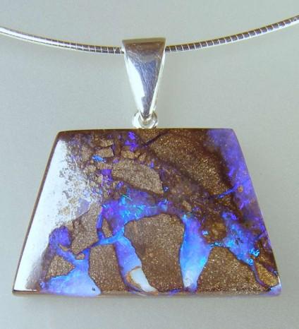 Boulder opal pendant - 27.39ct boulder opal pendant with silver bail
