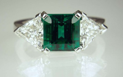 Emerald & diamond ring - 2.41ct emerald from Zambia.  Certified untreated - no clarity enhancement. Set with 1.26ct matched pair of E colour VS1 clarity trillion cut diamonds. Ring handmade in platinum.