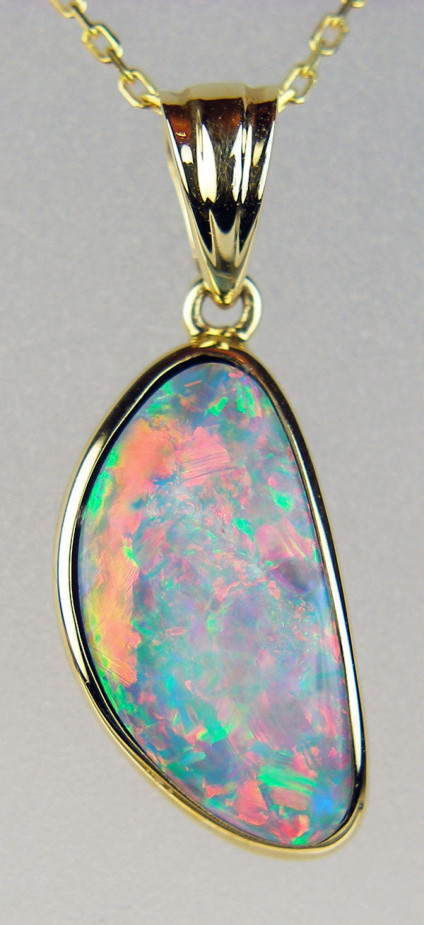 Opal doublet pendant in 14ct yellow gold - 3.80ct opal dublet set in 14ct yeloow gold. Chain to suit available separately. Pendant measures 25 x 9mm.