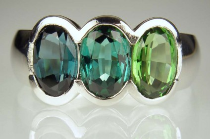 Tourmaline ring in palladium - 4.5ct of oval cut tourmalines in various shades of bluish green, rubover set in palladium