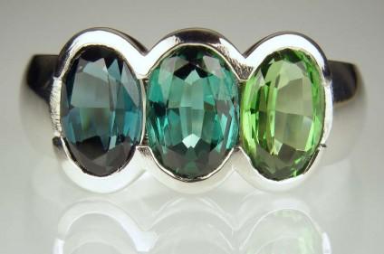 Tourmaline ring in palladium - 4.5ct of oval cut tourmalines in various shades of bluish green, rubover set in palladium