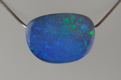 Boulder opal pendant - Spectacular vibrant, 35.11ct boulder opal drilled bead pendant, 24 x 17mm. From Queensland, Australia. This photograph doesn't do this opal justice!
