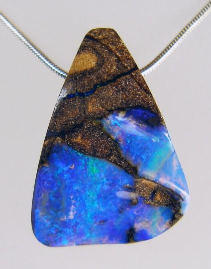 Boulder Opal Pendant - 43.81ct boulder opal drilled bead pendant. 24 x 32mm. From Queensland, Australia. Vibrant turquoise, green and blue colours shine out against the brown banded ironstone matrix in this stunningly beautiful and unique pendant.
