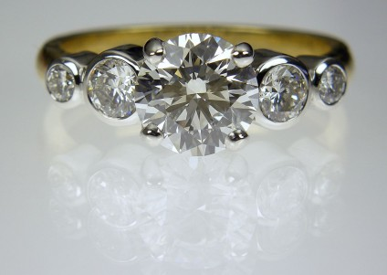 Diamond Ring in platinum & 18ct yellow gold - 5 Stone Diamond Ring 1.32ct G/SI2 (GIA certificated) diamond set with 0.5ct diamonds in platinum and 18ct yellow gold.