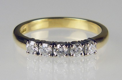 5 stone 1/2ct diamond ring - 5 stone diamond ring in 18ct white and yellow gold set with 5 x 0.10ct round brilliant cut diamonds in F colour VS clarity. This item is second hand, having been made by Just Gems for a customer who later replaced it with a larger model.
