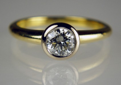 55pt diamond solitaire ring in 18ct white & yellow gold - 0.55ct rubover set diamond solitaire secondhand ring in 18ct white & yellow gold