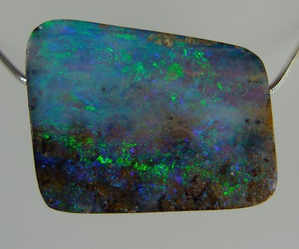 Boulder opal bead pendant - Spectacular and vibrant boulder opal from Queensland, Australia. 70.06ct boulder opal drilled bead pendant. 32 x 27mm. This photo doesn't do the opal justice, it is simply stunning.