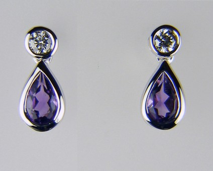 Amethyst & diamond earrings - 0.37ct pair of pear cut amethysts rubover set in 18ct white gold and suspended from a 0.08ct pair of round brilliant cut diamonds.