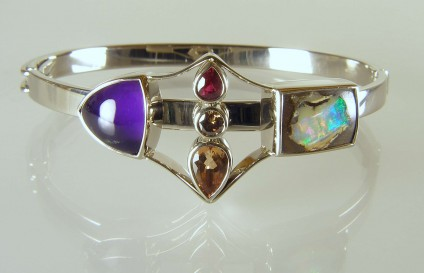 Amethyst & opal birthstone bangle - Bangle created using the birthstones of a family with three children.  Birthstones include topaz, ruby, diamond, opal and amethyst, all set in 18ct white gold.