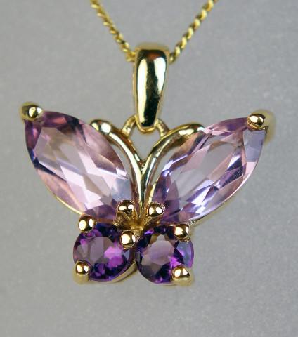 Amethyst butterfly pendant in 9ct - Butterfly pendant set with pretty faceted amethyst gemstones and suspended from an 18ct 9ct yellow gold chain