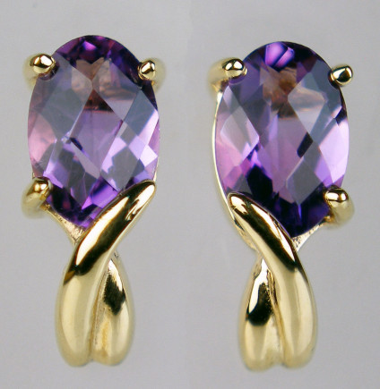 Amethyst chequerboard cut earstuds in 9ct yellow gold - Oval chequerboard cut amethysts set in 9ct yellow gold. These match a pendant on our site.