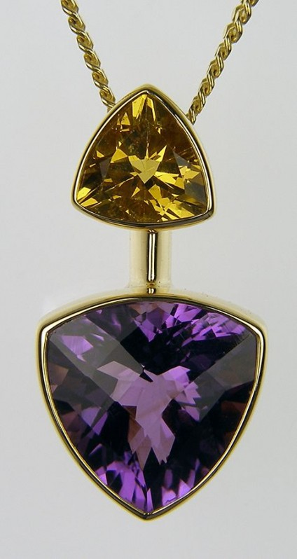 Amethyst & golden beryl pendant in 18ct yellow gold - Amethyst & Golden Beryl Pendant. Pendant of 7.66ct trillion cut amethyst set with a 1.69ct  golden beryl in 18 carat yellow gold. 29 x 15mm.