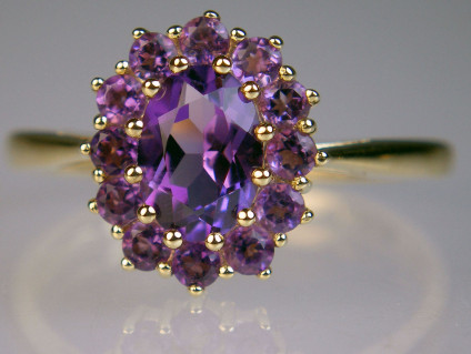 Amethyst cluster ring - Beautiful and richly coloured amethyst oval surrounded by round cut amethysts set in 9ct yellow gold ring
