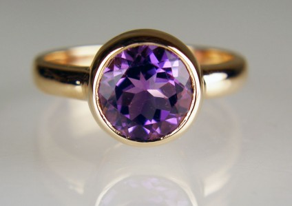 Amethyst ring in 18ct rose gold - 8mm round amethyst weighing 1.87ct rubover set in 18ct rose gold ring