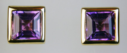 Amethyst suqare cut earstuds in a rubover 9ct setting - Square cut amethysts rubover set in 9ct yellow gold earstuds