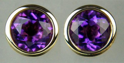 6mm round amethyst rounds rubover set in 9ct yellow gold earstuds - 0.95ct pair of amethyst rounds rubover set in 9ct yellow gold. Earstuds are 6.3mm.