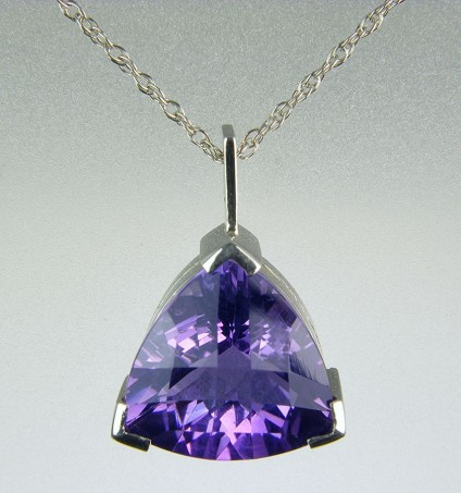 "Amethyst pendant in 18ct white gold - Amethyst pendant in 18ct white gold 2.2cm in length set with superbly cut mid lilac coloured amethyst on 18"" chain."