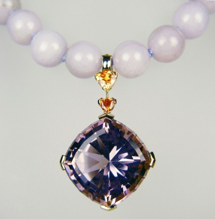 Ametrine, spessartine & lavendar jade necklace - 31.56ct ametrine, special cut by award winning lapidary, Ivan Willianson, set with 0.64ct and 0.26ct trillion cut spessartine (mandarin) garnets, mounted in 18ct yellow gold as a pearl enhancer. Worn with 10mm lavendar jadeite beads from Myanmar, hand knotted and with a gold plated silver, magnet clasp. A dramatic and unique piece, designed with skill and passion, by Helen Plumb of Just Gems.