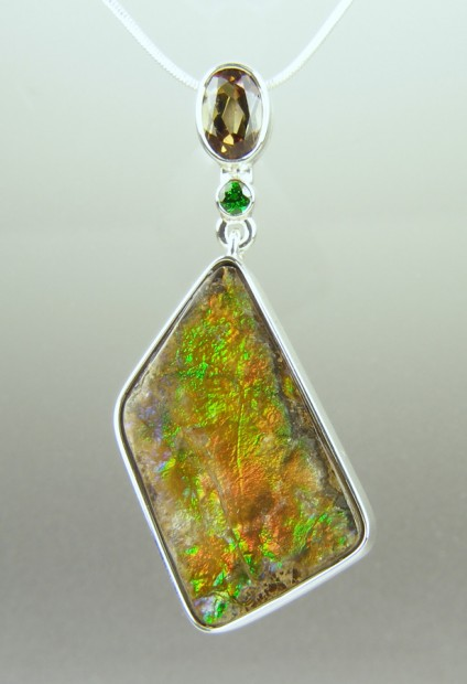 Ammolite ,andalusite & tsavorite pendant in silver - Freeform ammolite (opalised ammonite shell - fossilised) from Alberta, Canada, set with oval andalusite 0.99ct and 0.08ct round cut tsavorite garnet, in silver.