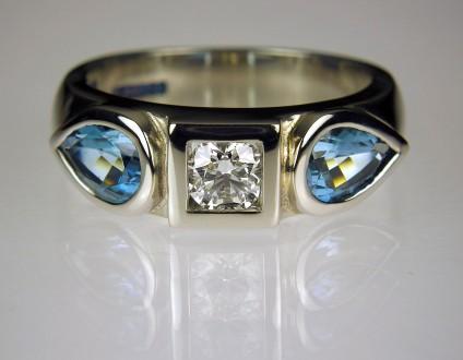Diamond & Aquamarine ring in Palladium - Diamond & aquamarine ring in palladium.  Set with 0.34ct E/SI1 GIA certificated diamond & 1.36ct pear cut aquamarines from Mozambique. Band 6mm wide.