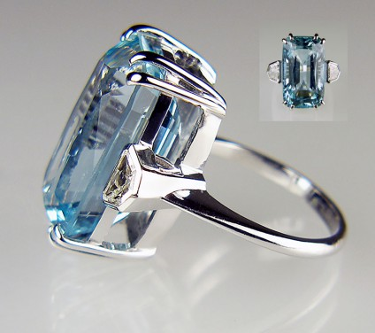 Aquamarine and diamond ring in 18ct white gold - 17.8ct rectangular cushion mixed cut aquamarine of mid blue/greenish blue colour saturation and flanked with a 0.51ct matched pair of shield cut diamonds in H colour SI clarity, mounted in an 18ct white gold ring