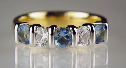 Aquamarine & diamond ring - 4mm round aquamarines & diamonds set in 18ct yellow gold ring with platinum veneers. Total diamond weight 0.47ct, aquamarine weight 0.67ct. Diamond grade F/VS.