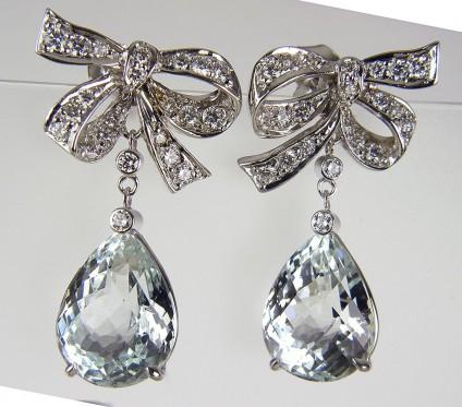 Aquamarine & Diamond Bow Earrings - Aquamarine bow earrings set with 9.17ct aquamarine briolettes & 0.64ct diamonds in 18ct white gold.