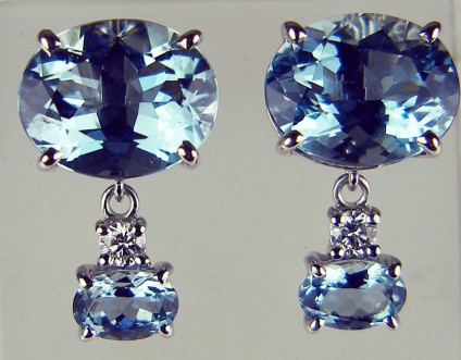 Aquamarine & diamond earrings - Beautiful pair of earrings consisting of 6.93ct fine quality mid blue oval cut aquamarines set with 0.12ct of diamonds in 18ct white gold