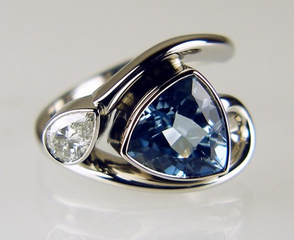 Aquamarine & diamond ring in palladium - 2.72ct aquamarine trillion cut set with 0.51ct pear cut diamond H colour SI2 clarity, accompanied by GIA report, and mounted in a dramatic, flowing style, palladium ring.