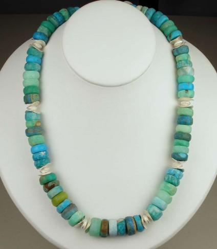 Turquoise miscellany gemstone bead necklace - Rough hewn button bead necklace with assorted natural gemstones in shades of turquoise, blue and green with silver beads and clasp.  Gemstone varieties include turquoise, amazonite, chrysoprase, chrysocolla, Andean opal, Finnish Jade (variety of serpentine) & hemimorphite.