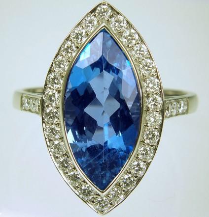 Aquamarine & Diamond Ring in Platinum - Aquamarine & diamond ring. 3.29ct marquise cut deep blue aquamarine set with 50 points of E/VS diamonds in platinum.