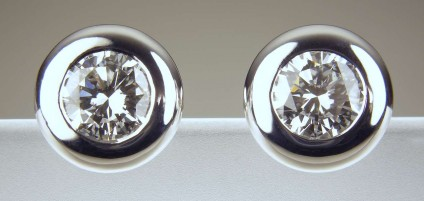 Diamond Earrings - Round brilliant cut certified diamonds (G/H colour SI clarity) totalling 1.41ct in 18ct white gold rubover setting.