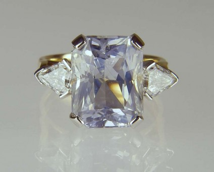 Sapphire & diamond ring - 8.42ct pale blue sapphire set with 0.79ct shield cut diamonds in platinum and 18ct yellow gold.  This ring was made using the customer's aunt's wedding band.  A nice combination of new gemstones made up using a piece of old jewellery with sentimental value.