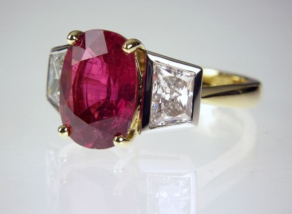 Ruby & Diamond Ring - Ruby & diamond ring - 4.12ct natural, untreated (SSEF certificate confirming there is no evidence of heat treatment or clarity enhancement) ruby 4.12ct, set with a matched pair of trapeze cut diamonds totalling 1.49ct, in platinum and 18ct yellow gold.