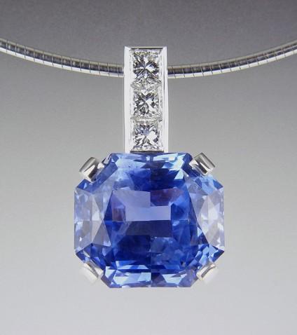 Sapphire & Diamond Pendant - Blue sapphire & diamond pendant in 18ct white gold.  Set with exceptional quality GIA certificated (untreated) 13ct cornflower blue Sri Llankan sapphire.