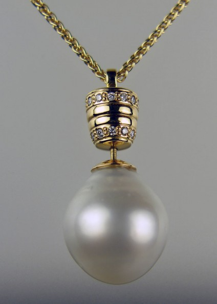 South Sea Pearl Pendant - 16-18.5mm South Sea semi baroque, drop pearl mounted with 16 x 1.4mm round diamonds, in 18ct yellow gold and suspended from a spiga chain. Unique moveable bail design.