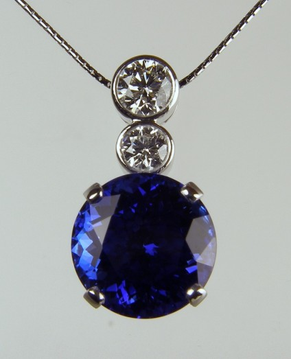 Tanzanite & diamond pendant - Large round brilliant cut tanzanite of 16.8ct set with 0.52ct and 1.01ct F colour VS2 clarity diamonds with accompanying GIA reports mounted as a pendant in 18ct white gold