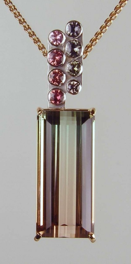 """Watermelon tourmaline & sapphire pendant in rose & white gold - Exceptionally high clarity, 38.34ct watermelon tourmaline set with 1.57ct of round brilliant cut sapphires in 18ct rose and white gold, suspended from a 16-18"""" adjustable 18ct rose gold spiga chain"""